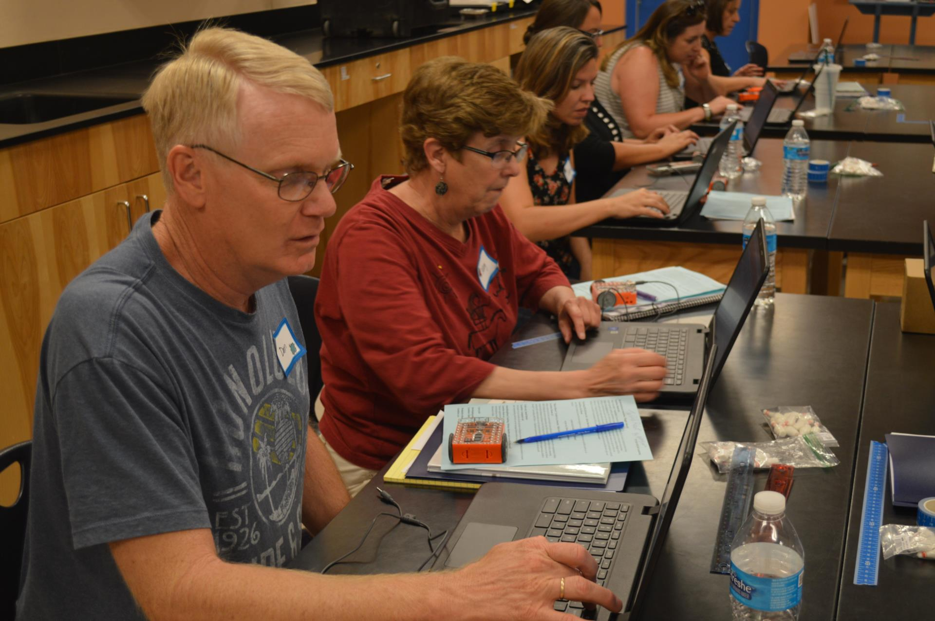 teachers learning coding with robots