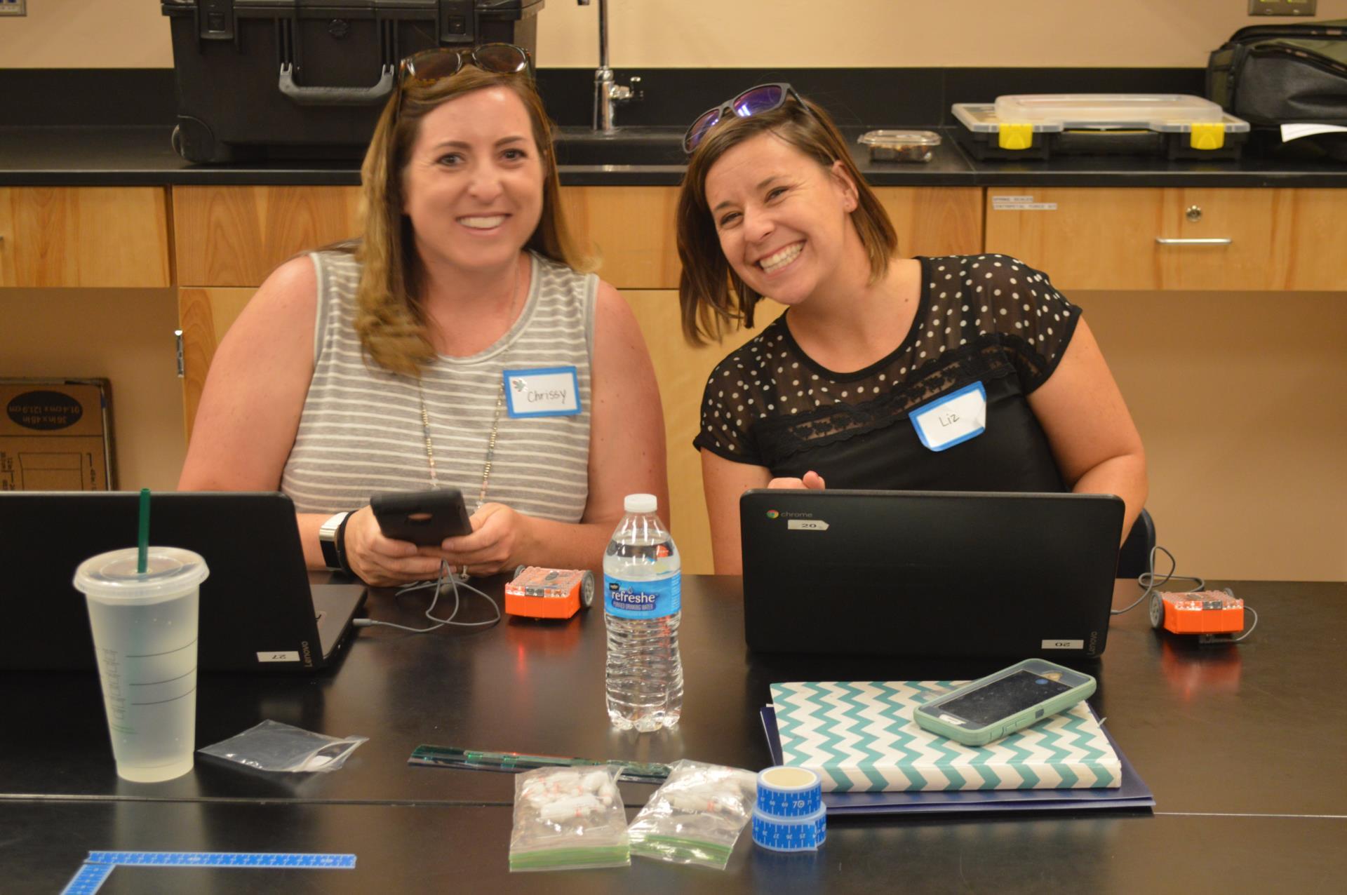 teachers enjoying learning robots