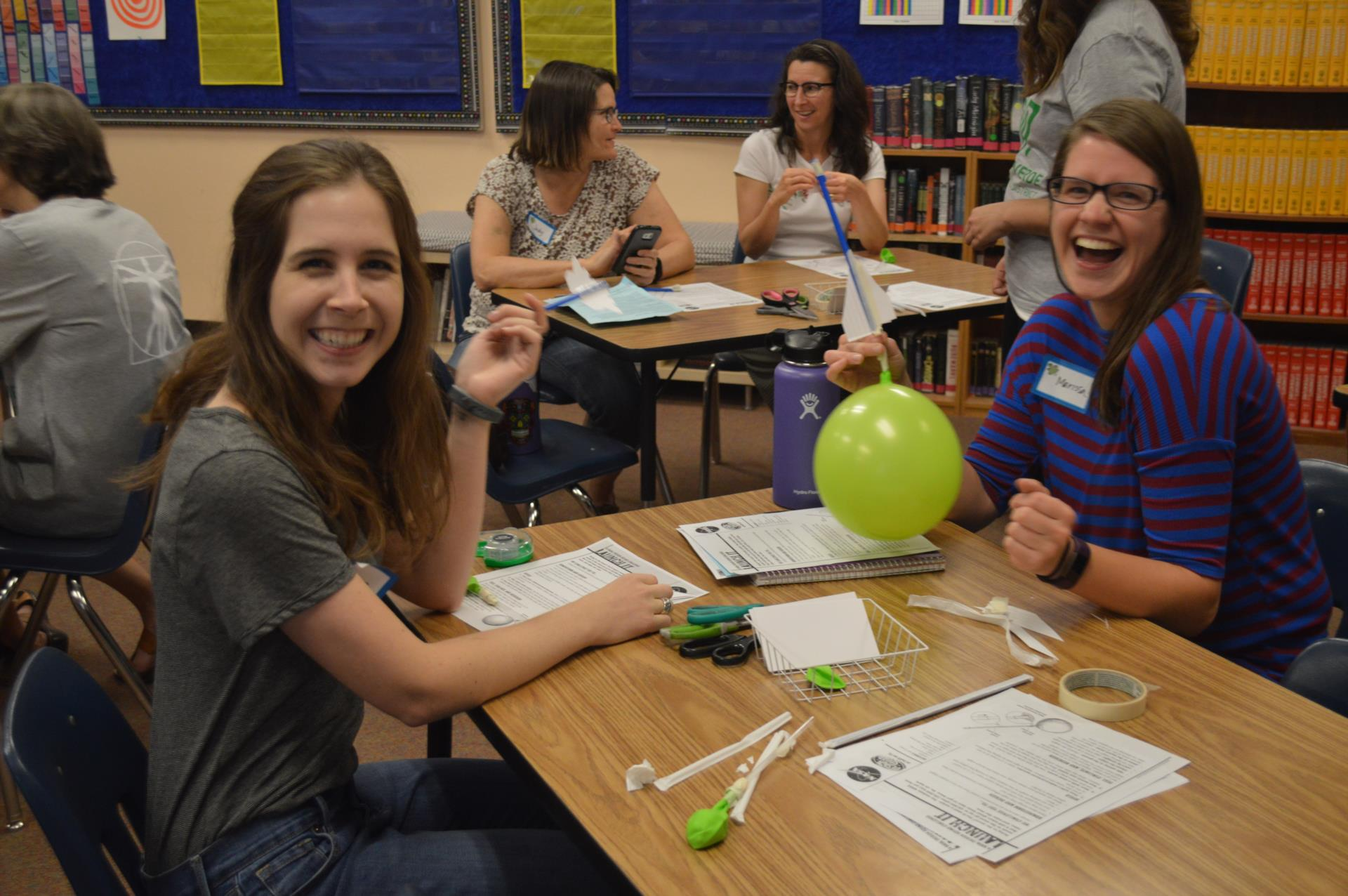 teachers learning engineering concepts with balloons
