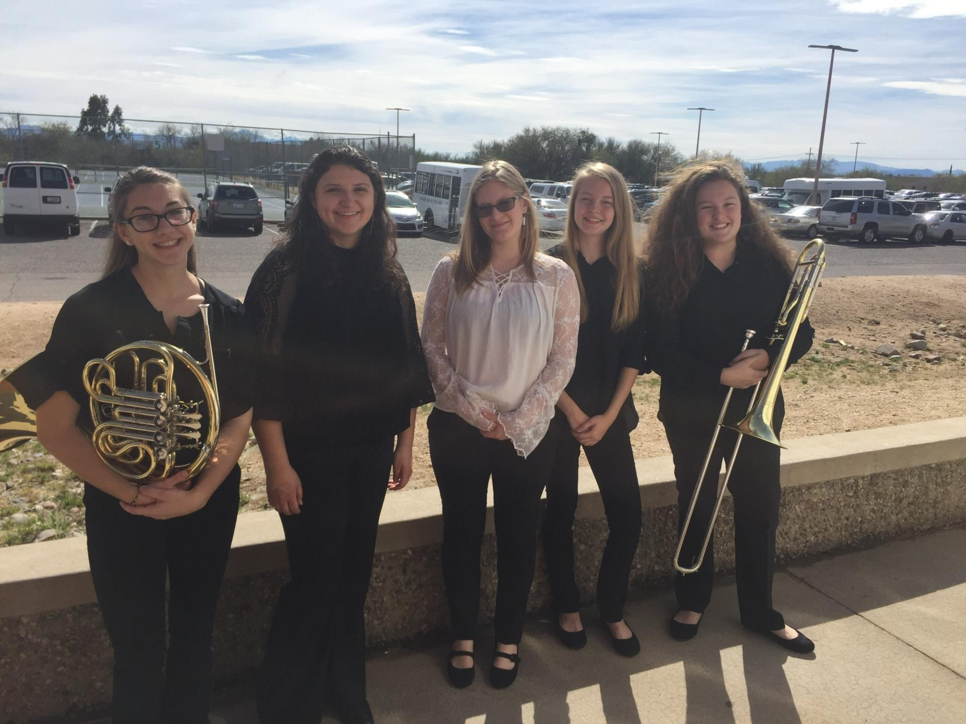 High school students with french horn and trombone