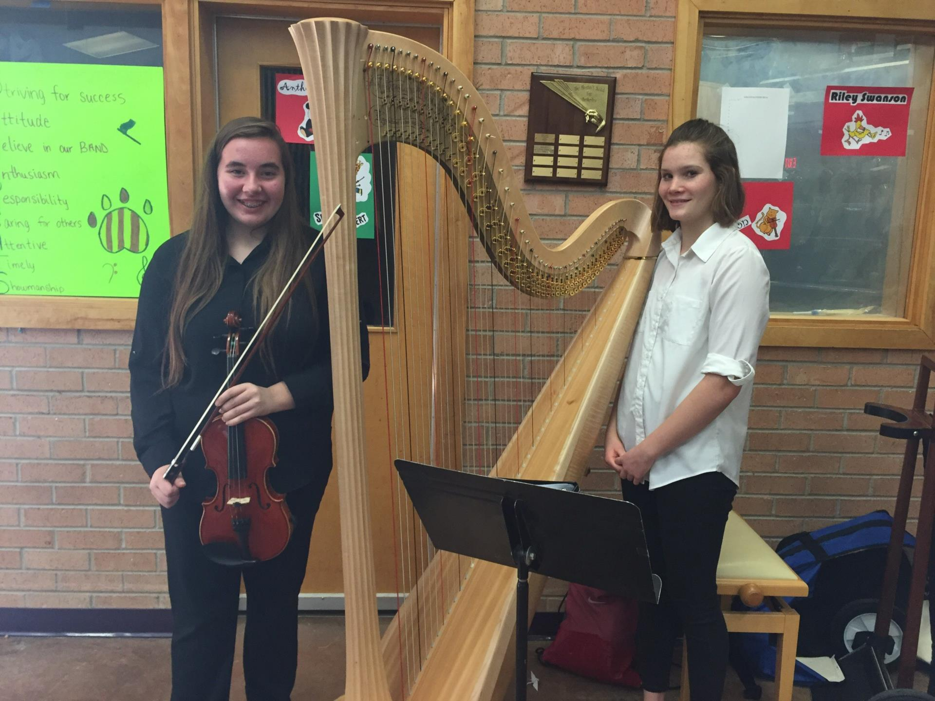 students with violin and harp