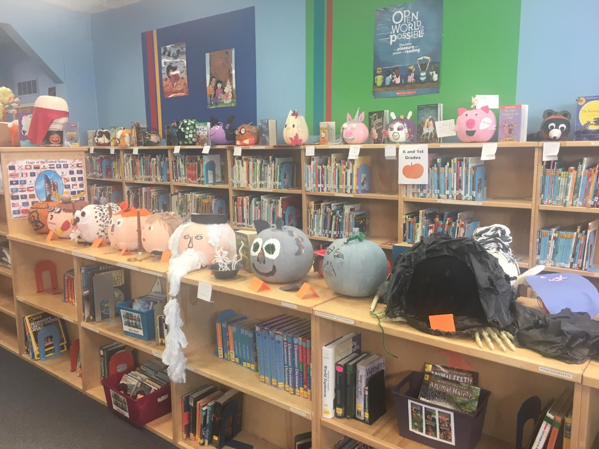 decorated pumpkins on bookshelves