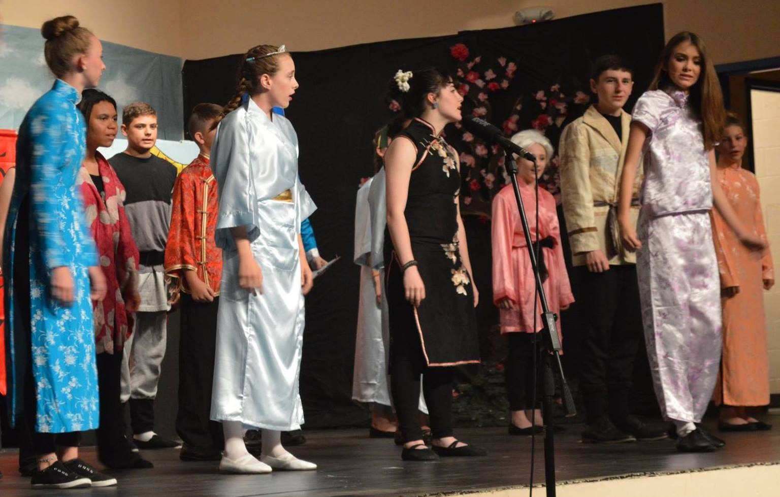 students perform Mulan Jr.