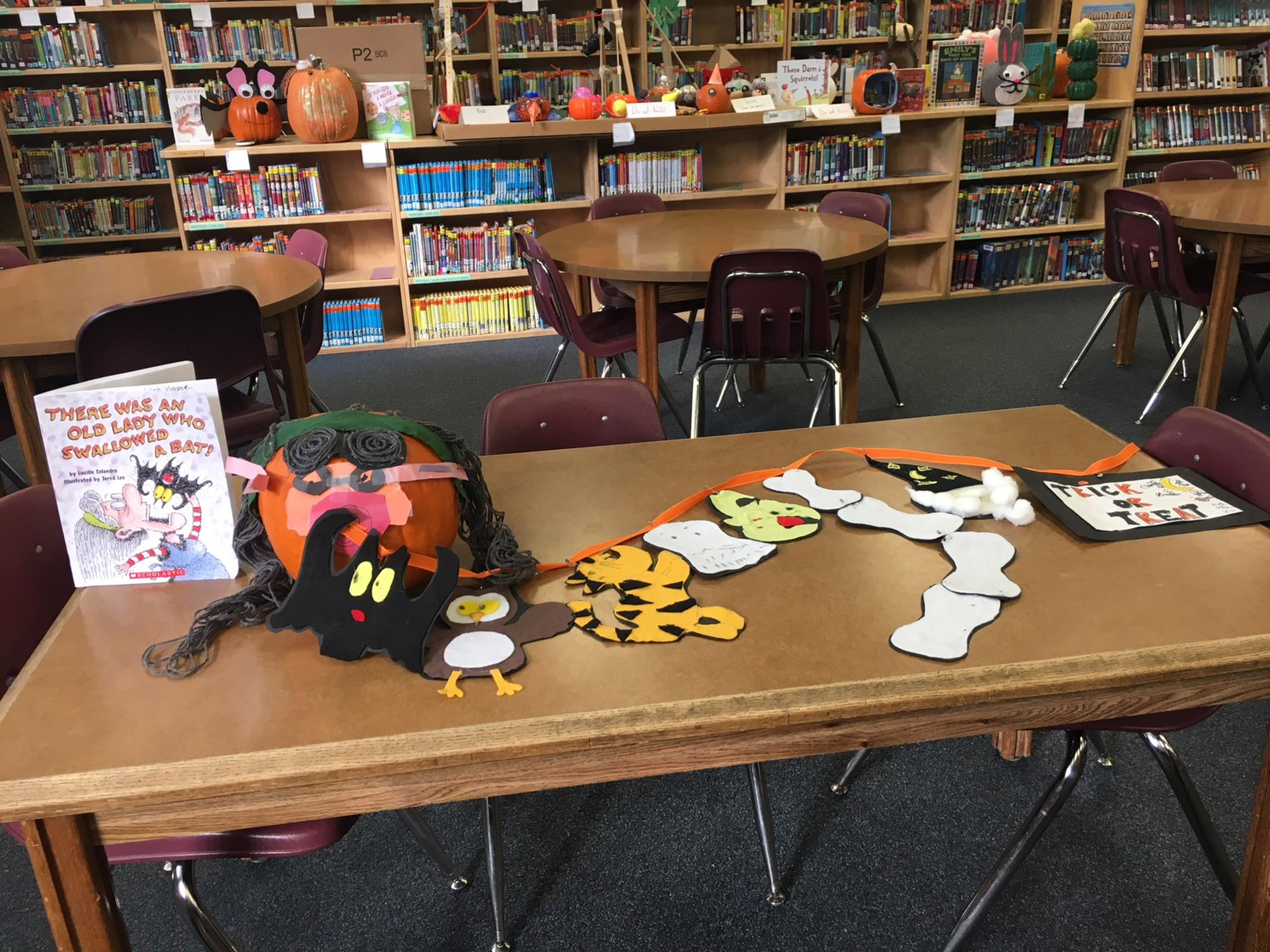 decorated pumpkins in library