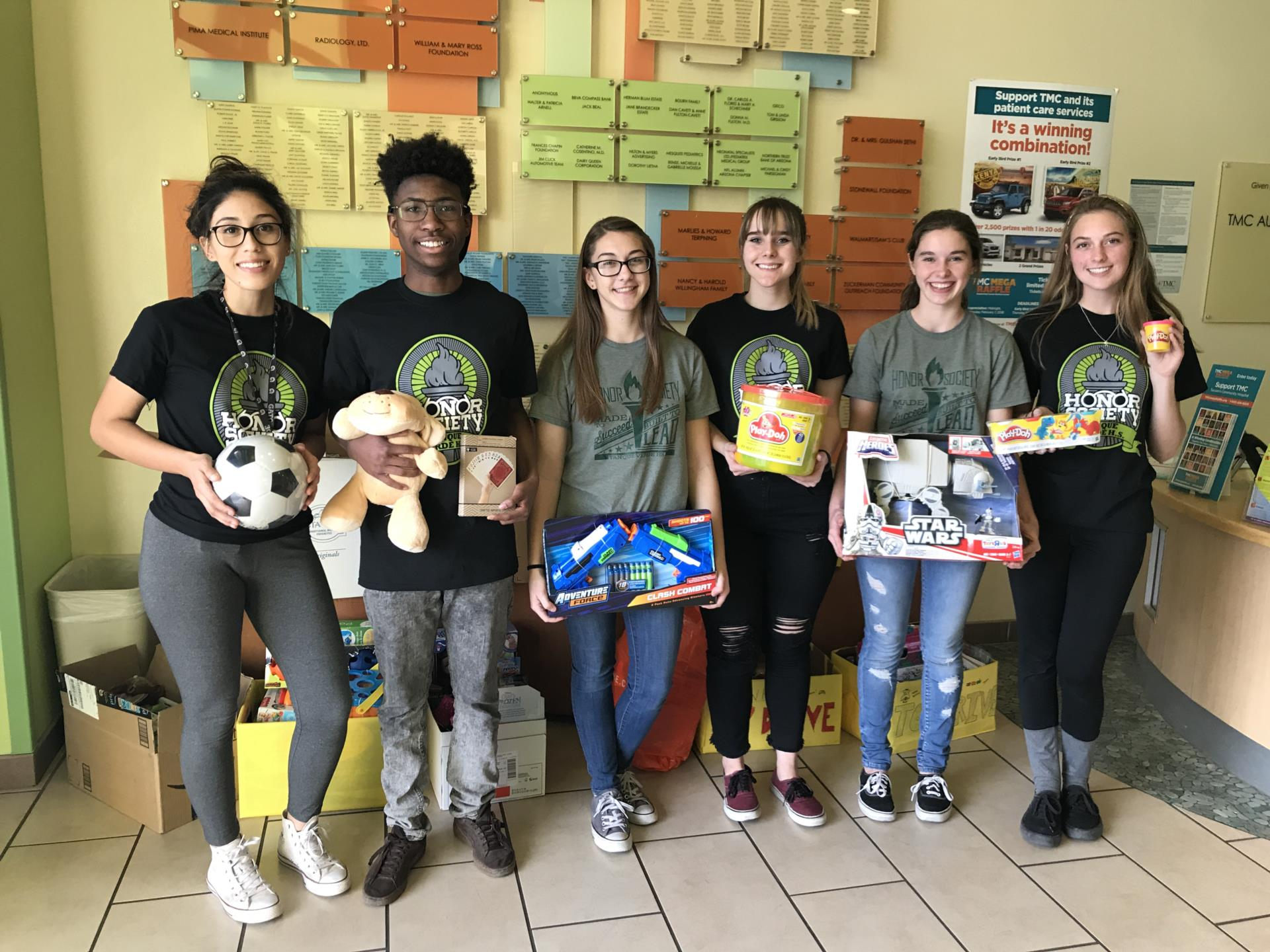 students holding donated toys