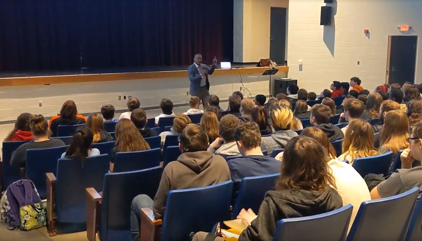 Dvaid Cook presenting to students at LHS